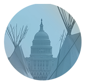 Circular image with two teepees shown in the foreground with the US Capitol in the background. Image is tinted light blue.